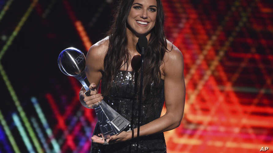 Alex Morgan, a member of the U.S women's national soccer team, accepts the award for best female athlete at the ESPY Awards, July 10, 2019, at the Microsoft Theater in Los Angeles.