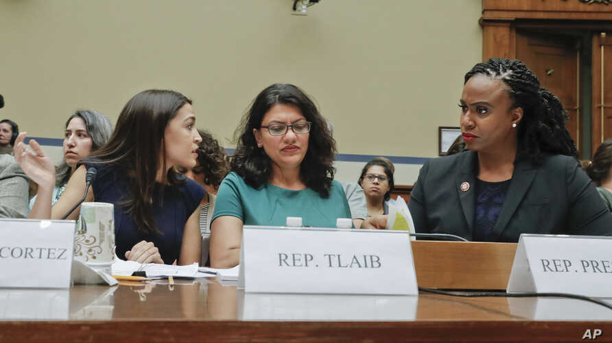 From L to R, Rep. Alexandria Ocasio-Cortez, D-NY., Rep. Rashida Tlaib, D-Mich., and Rep. Ayanna Pressley, D-Mass., wait to testify before the House Oversight Committee hearing on family separation and detention centers, July 12, 2019 on Capitol Hill.