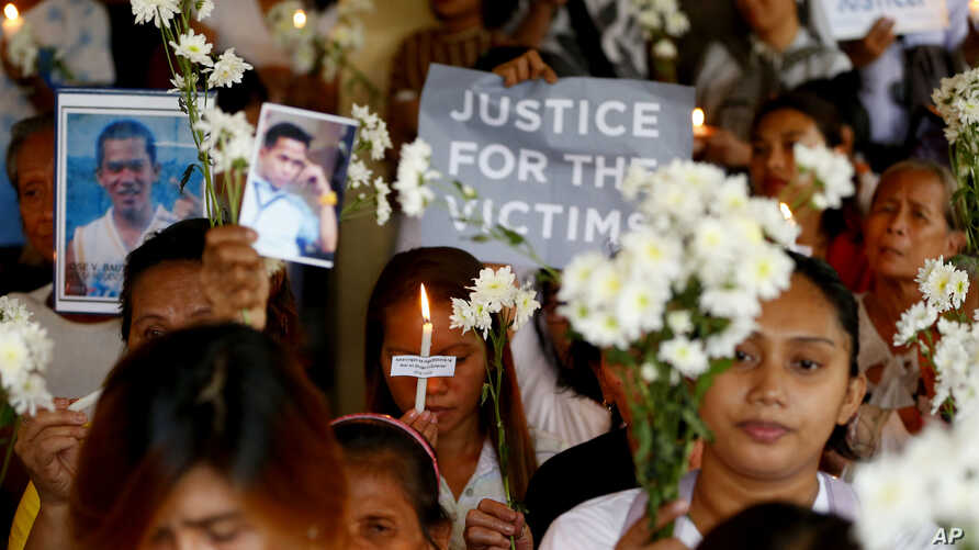Relatives of victims of President Rodrigo Duterte's so-called war on drugs hold a memorial for their loved ones, at a church in Manila, Philippines, March 17, 2019.