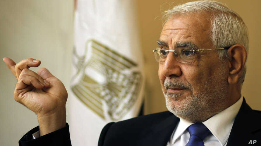 FILE - Abdel-Moneim Aboul-Fotouh talks during interview with the Associated Press at his home in Cairo, Egypt, Nov. 18, 2013.