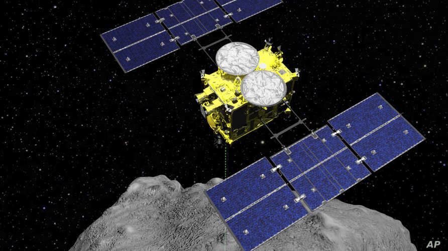 FILE - A computer-rendered image released by the Japan Aerospace Exploration Agency (JAXA) shows the Hayabusa2 spacecraft above the asteroid Ryugu.