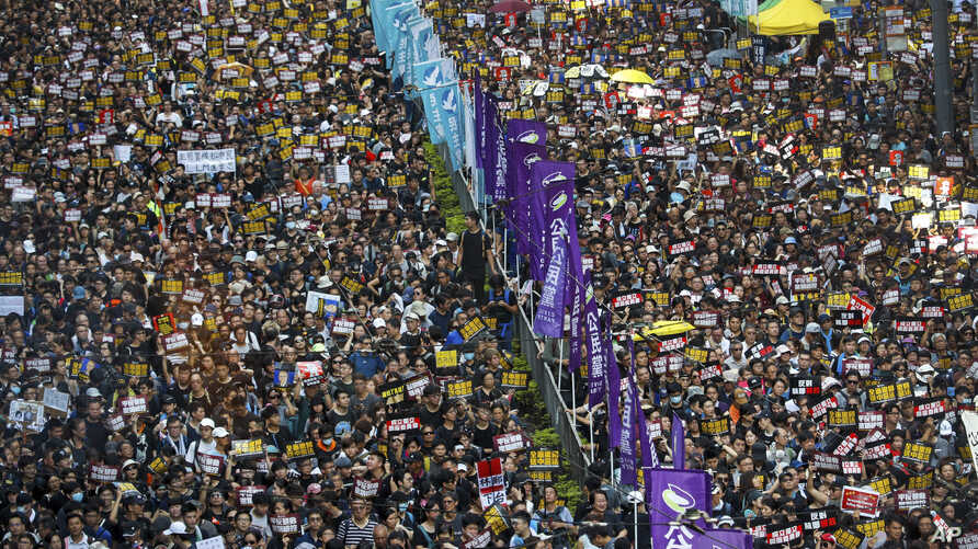 Protesters take part in a march on a street in Hong Kong, July 21, 2019.