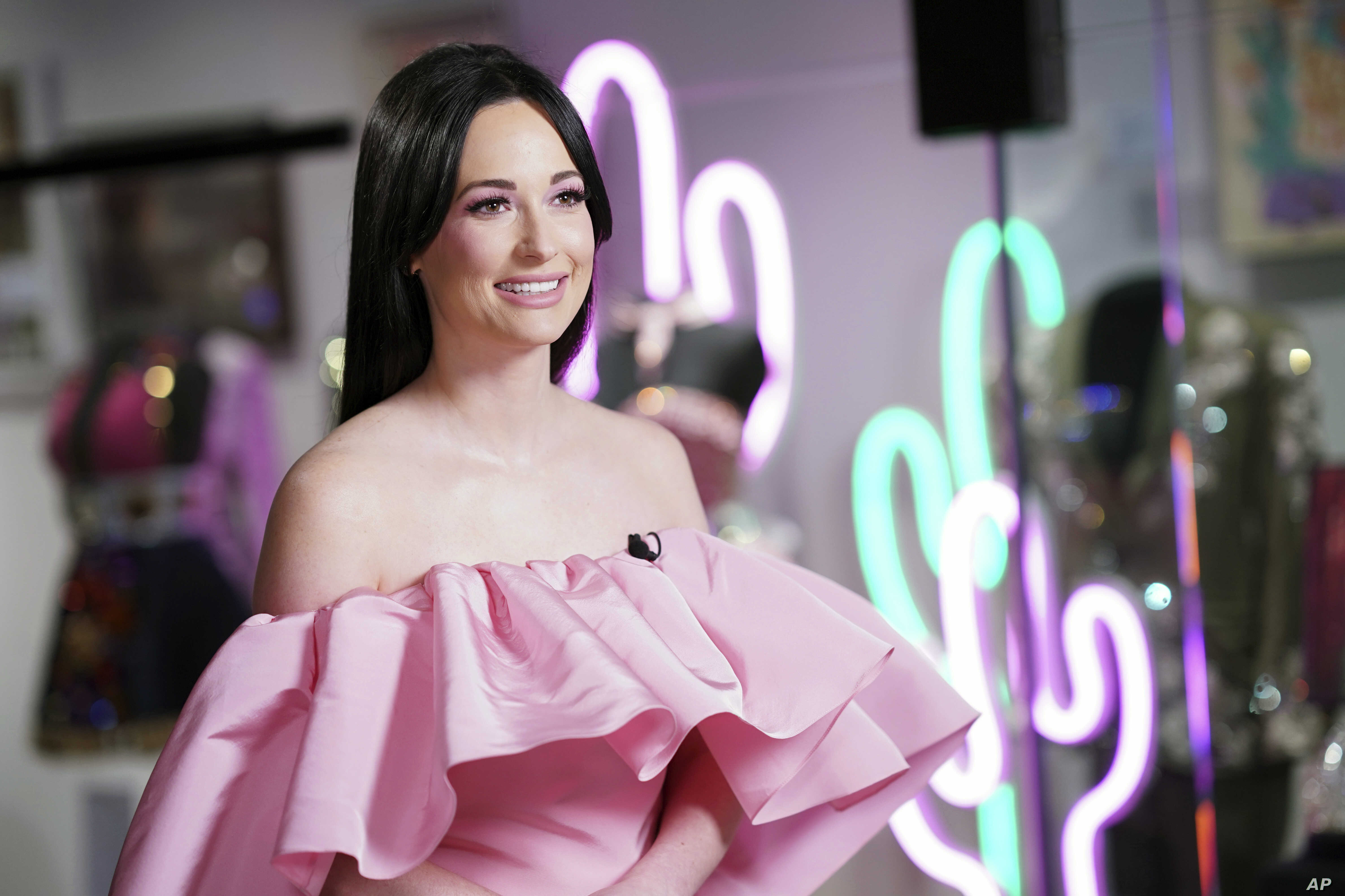 Country singer Kacey Musgraves poses in front of her new exhibit at the Country Music Hall of Fame and Museum in Nashville, Tennessee, July 1, 2019.