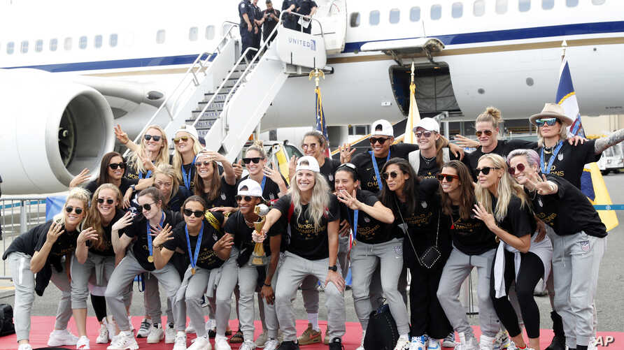 Members of the United States women's soccer team arriving at Newark Liberty International Airpor, New Jersey, July 8, 2019