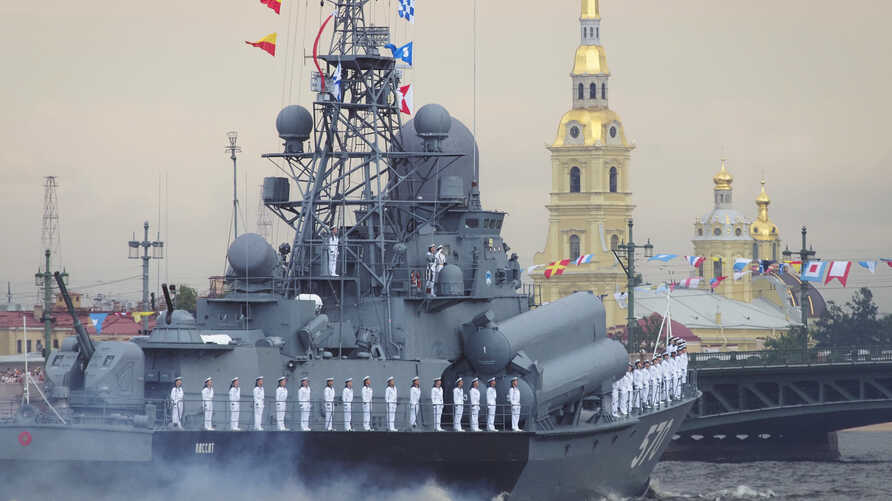 Warships float at the Neva River during the Navy Day parade in St.Petersburg, Russia, July 28, 2019.