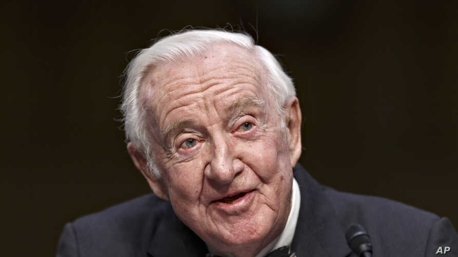 Retired Supreme Court Justice John Paul Stevens testifies on the ever-increasing amount of money spent on elections as he appears before the Senate Rules Committee on Capitol Hill in Washington, Wednesday, April 30, 2014.