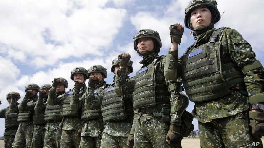 FILE - The first team of Taiwan artillerywomen poses for the press during the annual Han Kuang exercises in Pingtung County, Southern Taiwan, May 30, 2019. The U.S. approved the sale of $2.2 billion worth of military equipment to Taiwan, July 9, 2019.