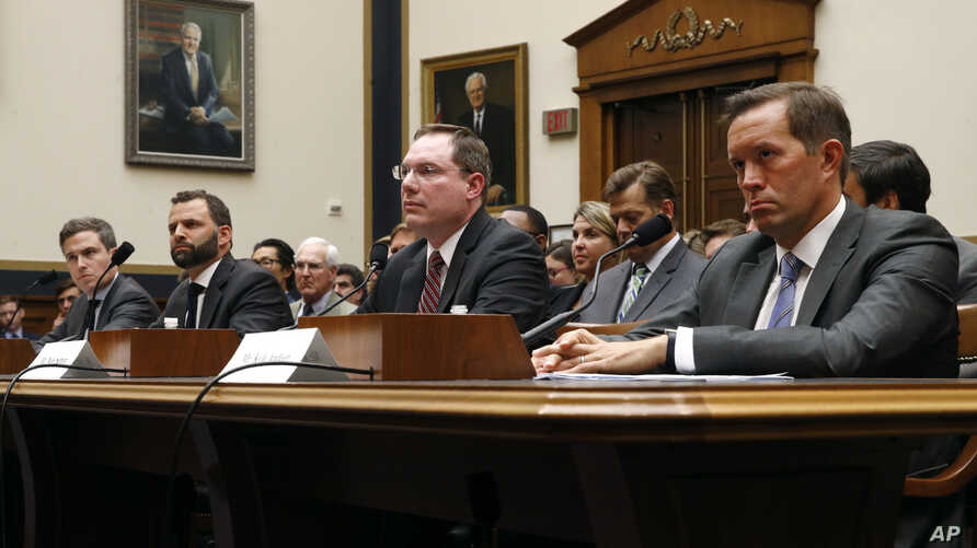 From left, Adam Cohen (Google), Matt Perault (Facebook), Nate Sutton (Amazon) and Kyle Andeer (Apple) listen to a question during a House Judiciary subcommittee hearing, July 16, 2019, on Capitol Hill in Washington.