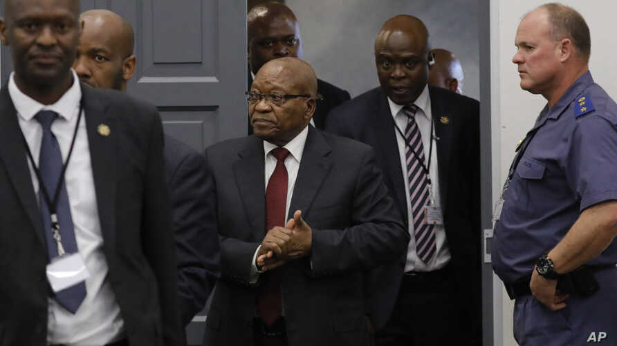 Former South African president Jacob Zuma, center, arrives to testify before a state commission probing wide-ranging allegations of corruption in government and state-owned companies, in Johannesburg, South Africa, July 17, 2019.