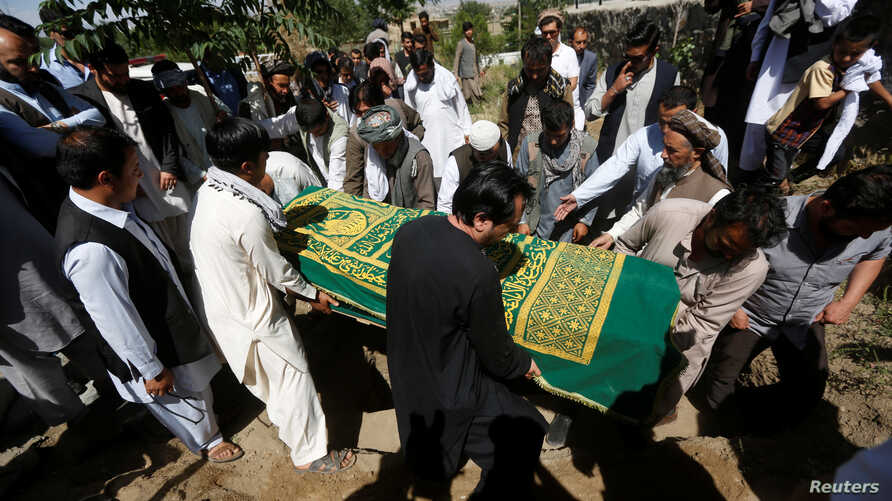 Afghans take part in a burial ceremony of a journalist, in Kabul, Afghanistan June 7, 2016.