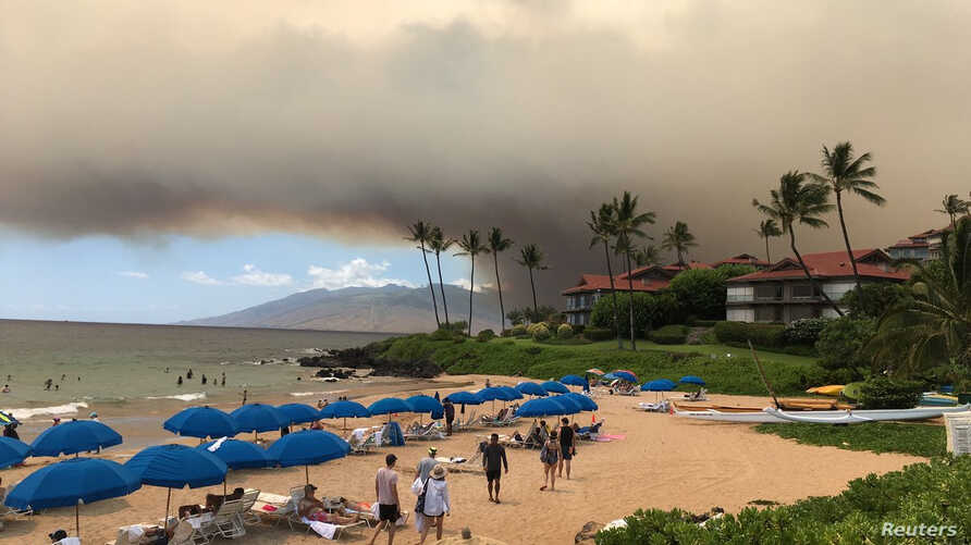 Smoke blankets the sky as a wildfire spreads in Maui, Hawaii, in this July 11, 2019, photo obtained from social media.