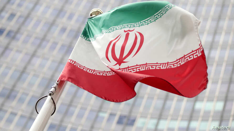 The Iranian flag flutters in front the International Atomic Energy Agency (IAEA) headquarters in Vienna, Austria, July 10, 2019.
