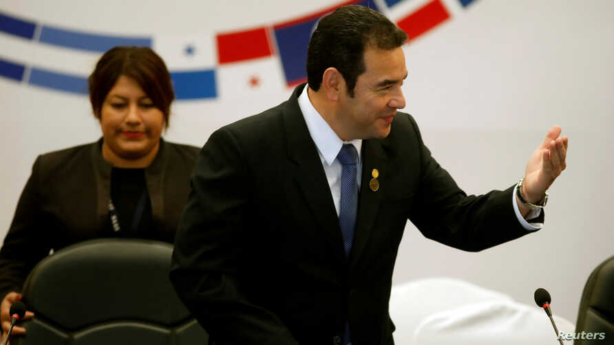 Guatemala's President Jimmy Morales gestures during a meeting of the Central American Integration System (SICA), in Guatemala City, Guatemala, June 5, 2019.