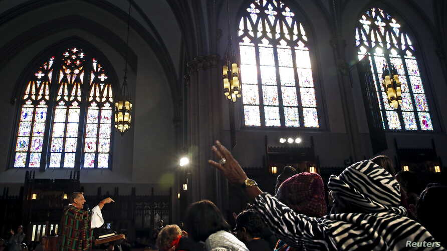 A priest delivers a sermon during Mass at Saint Sabina Church in Chicago, Illinois, Nov. 22, 2015.
