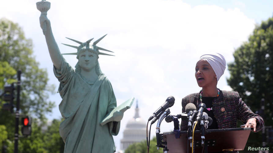 Representative Ilhan Omar (D-MN) addresses a small rally on immigration rights at the temporary installation of a replica of the Statue of Liberty at Union Station in Washington, May 16, 2019.