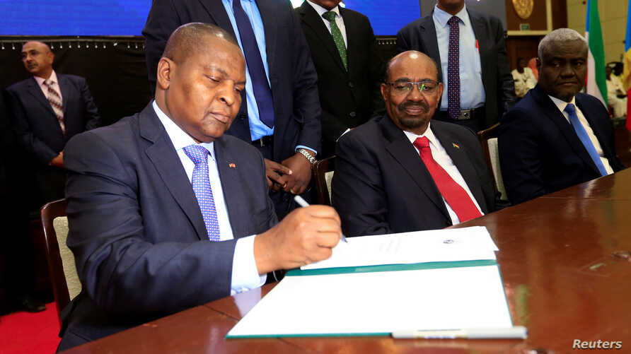 Central African Republic President Faustin Archange Touadera signs a peace deal between the Central African Republic government and 14 armed groups following two weeks of talks in the Sudanese capital Khartoum, Sudan, February 5, 2019.