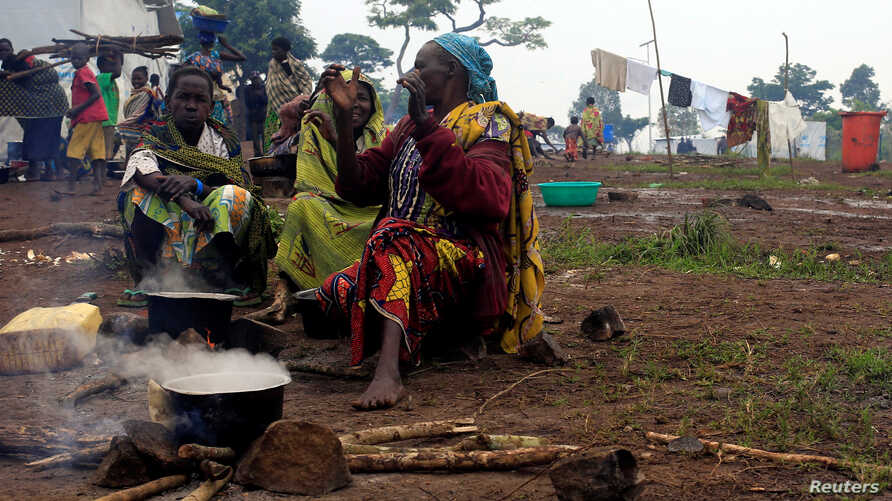 Congolese families, who fled from Democratic Republic of, prepare meals at United Nations High Commission for Refugees' (UNHCR) Kyangwali refugee settlement camp, Uganda, Mar. 19, 2018.