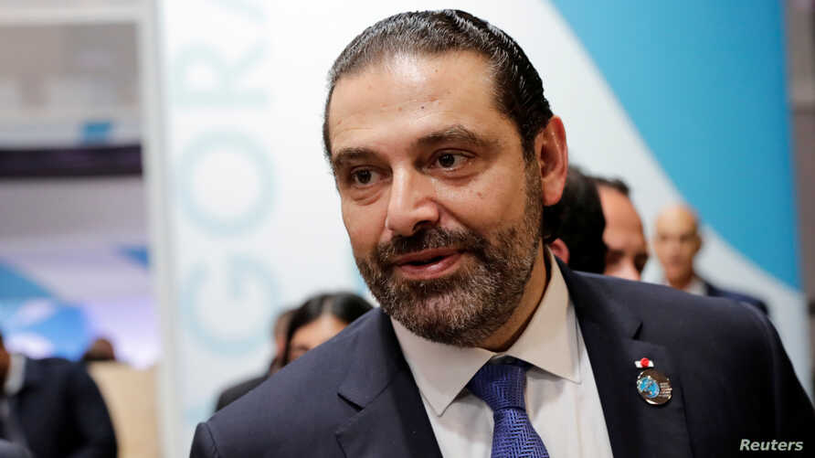 FILE - Lebanon's Prime Minister Saad Hariri gestures during the Paris Peace Forum after the commemoration ceremony for Armistice Day, 100 years after the end of the First World War, in Paris, Nov. 11, 2018.