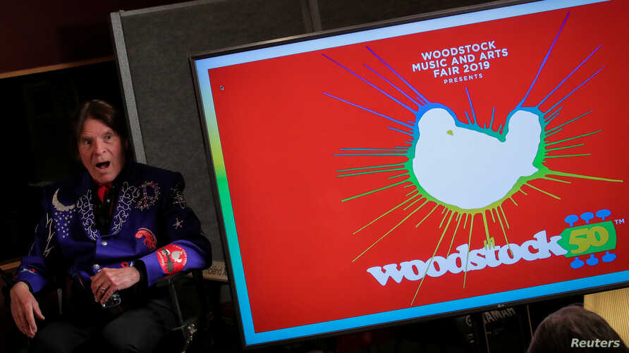 FILE - Singer John Fogerty speaks during the announcement event for the lineup for the Woodstock 50th Anniversary concert in New York, March 19, 2019.