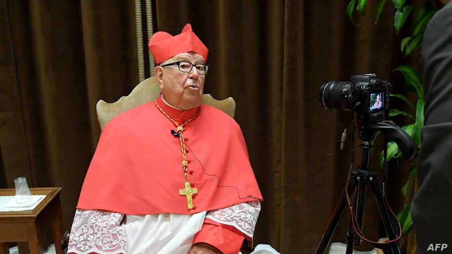 FILE - Newly-appointed Cardinal, Mexico's Sergio Obeso Rivera, speaks with journalists in the Apostolic Palace at St Peter's Basilica in The Vatican, June 28, 2018.