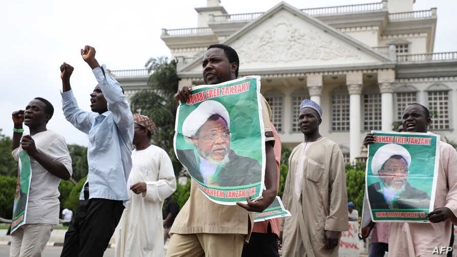 Hundreds of Shi'ites demonstrate in Abuja, on July 10, 2019, to demand the release of the leader of the Islamic Movement in Nigeria (IMN) Sheikh Ibrahim Zakzaky, a day after clashes with police.