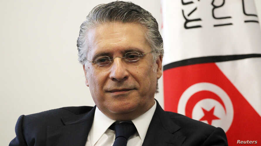 In this file picture taken on Aug. 2, 2019, Nabil Karoui, Tunisian media magnate and would-be presidential candidate submits his candidacy to Tunisia's electoral commission in the capital Tunis.