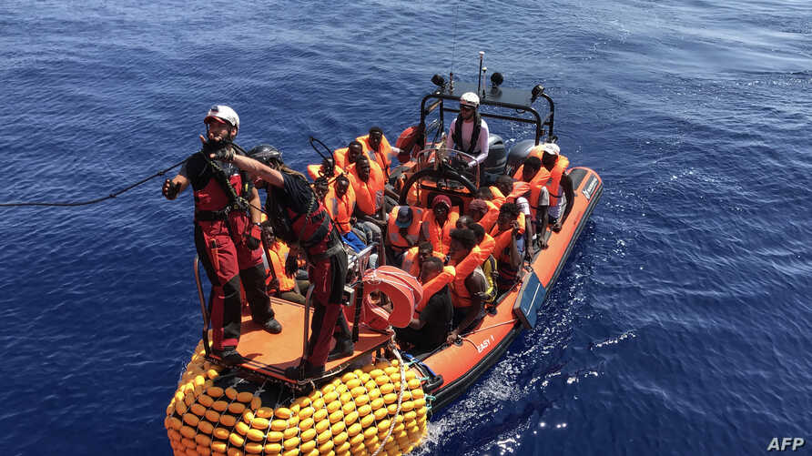 An inflatable dinghy belonging to the Ocean Viking rescue ship, operated by French NGOs SOS Mediterranee and Medecins sans Frontieres (MSF), transports migrants rescued from their dinghy during an operation in the Mediterranean Sea, Aug. 12, 2019.
