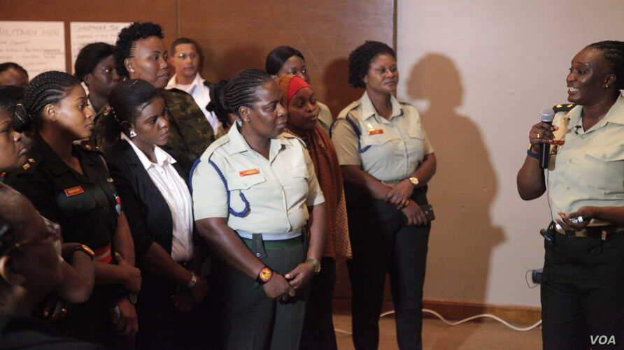 Women from militaries across the world attend the first day of an AFRICOM event in Ghana's capital, Accra. (Stacey Knott/VOA)