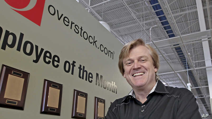 FILE - Patrick Byrne, then chairman and CEO of OverStock.com, at the company warehouse outside Salt Lake City, March 25, 2010.