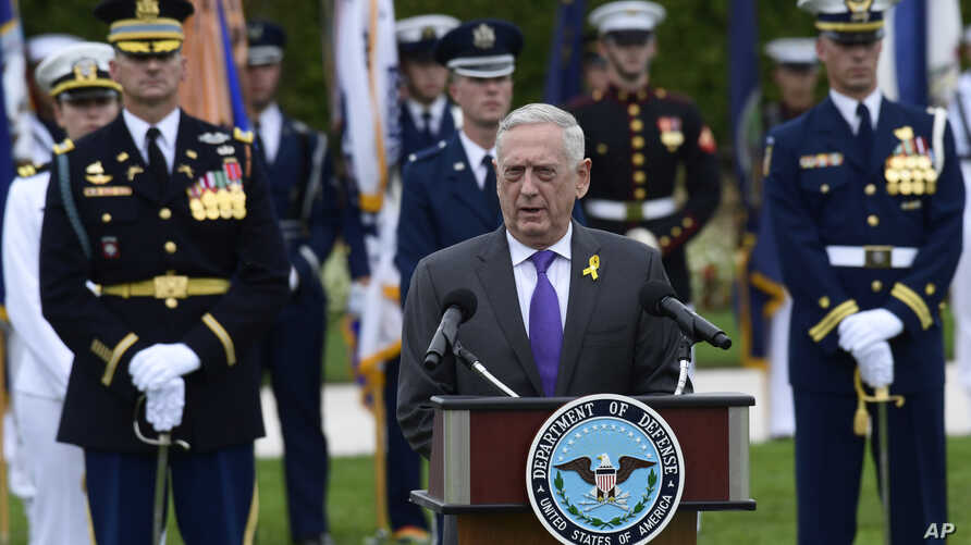 FILE - Defense Secretary Jim Mattis speaks during the 2018 POW/MIA National Recognition Day Ceremony at the Pentagon in Washington, Sept. 21, 2018.