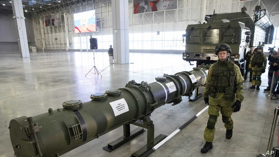 A Russian military officer walks past the 9M729 land-based cruise missile