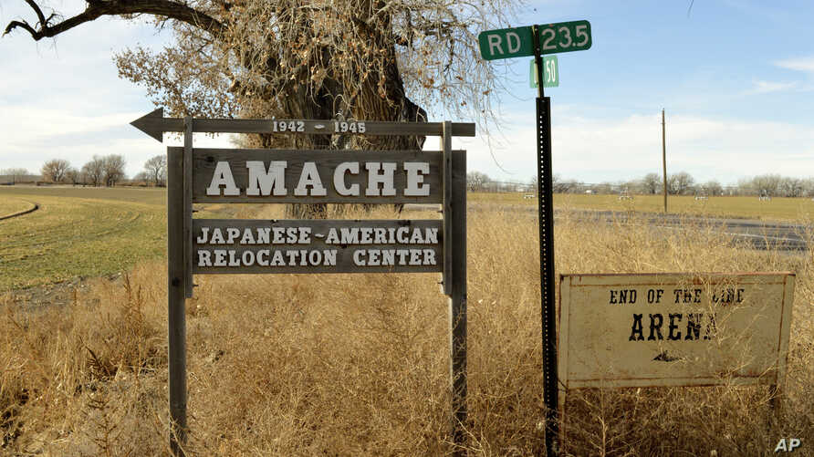 FILE - This Jan. 18, 2015, file photo shows a sign at the entrance to Camp Amache, the site of a former World War II-era Japanese-American internment camp in Granada, Colo.