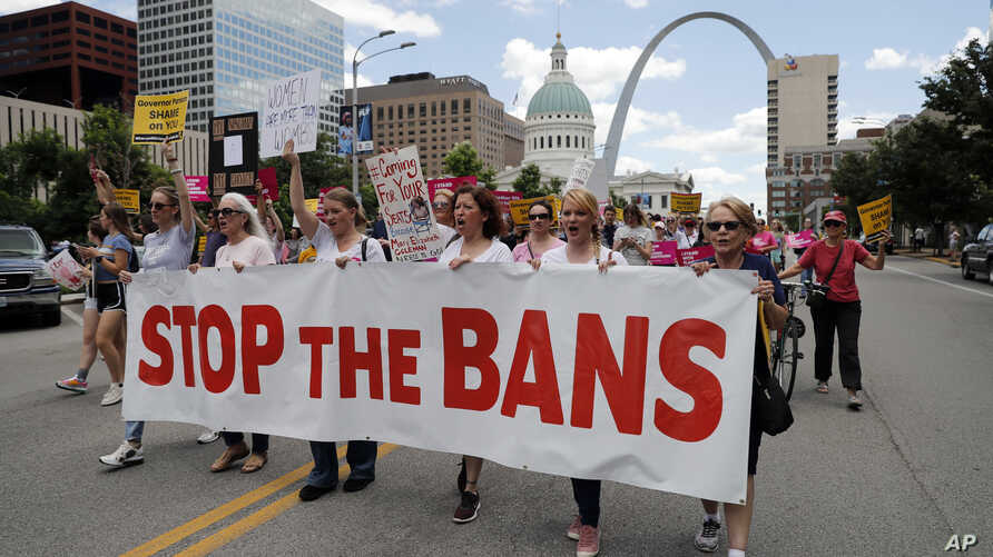 FILE - Abortion-rights supporters march in St. Louis, May 30, 2019.