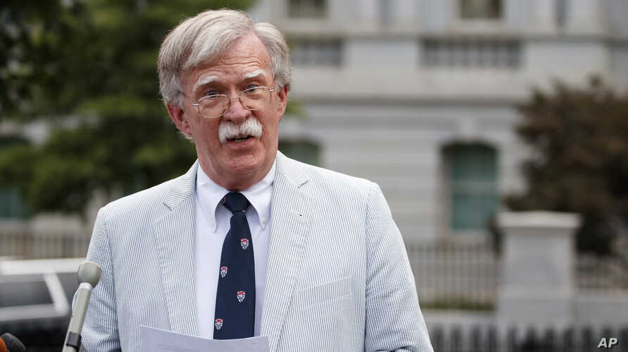 National security adviser John Bolton speaks to media at the White House in Washington, Wednesday, July 31, 2019.