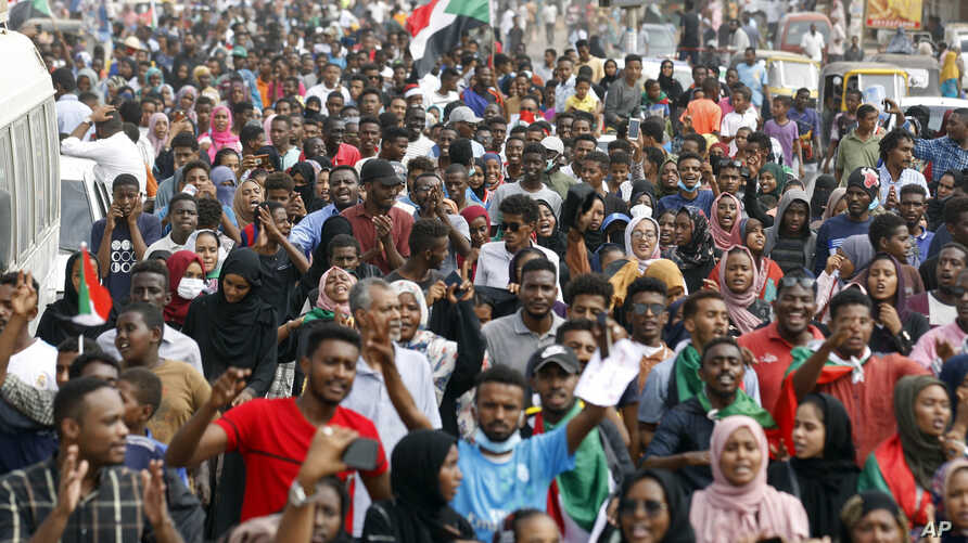 Sudanese protesters march during a demonstration in Khartoum, Sudan, Thursday, Aug. 1, 2019.