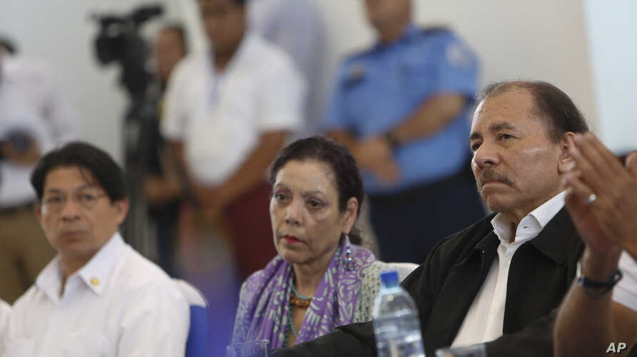 FILE - Nicaragua's President Daniel Ortega, right, attends the opening of a national dialogue in Managua, Nicaragua, May 16, 2018. The government is reportedly saying talks with the opposition are done.