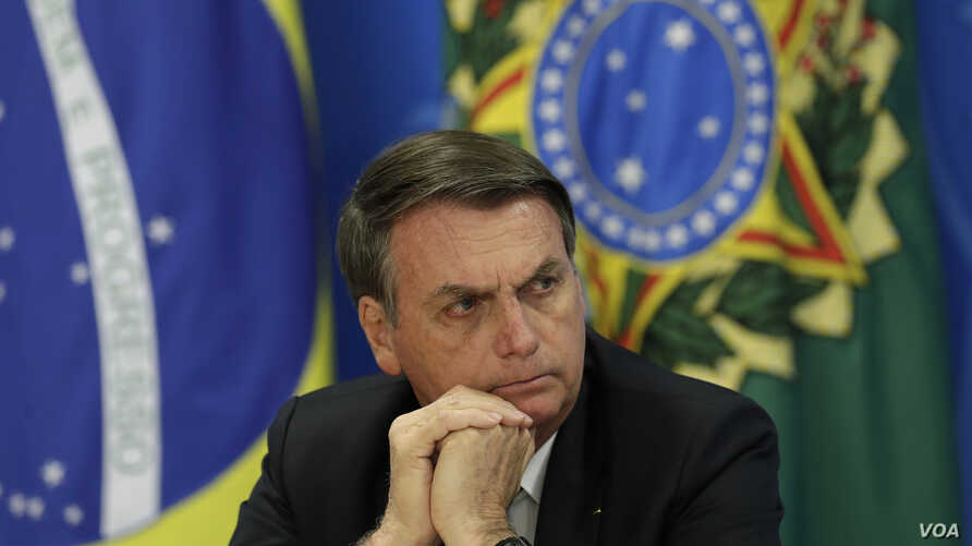 Brazil's President Jair Bolsonaro holds a press conference in Brasilia, Brazil, Aug. 1, 2019.