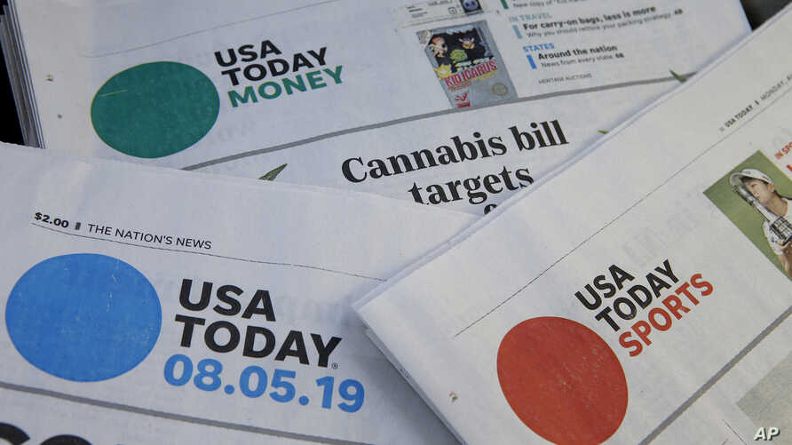 Sections of Monday's USA Today newspaper rest together in Norwood, Mass.,  Aug. 5, 2019.