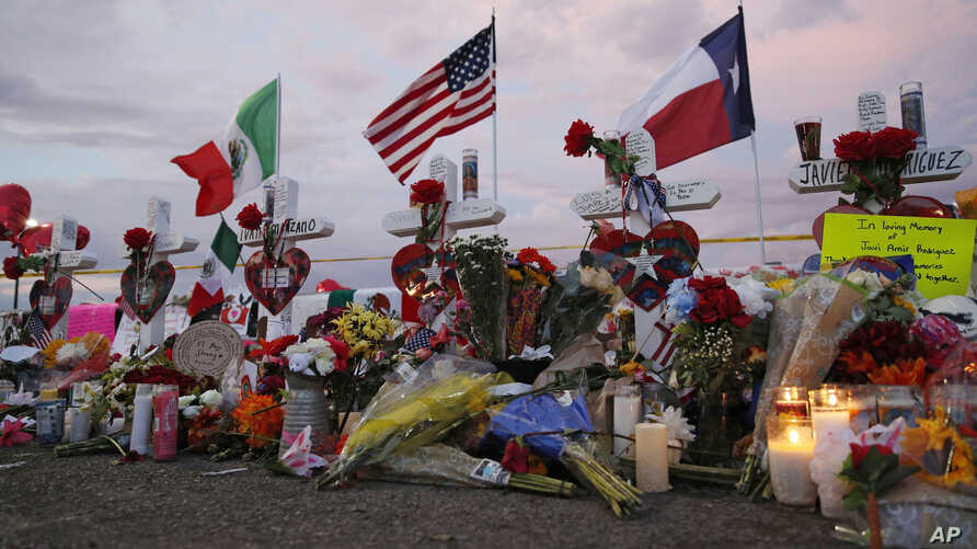 Flags fly over crosses at a makeshift memorial near the scene of a mass shooting, Aug. 4, 2019, at a shopping complex, Aug. 6, 2019, in El Paso, Texas.