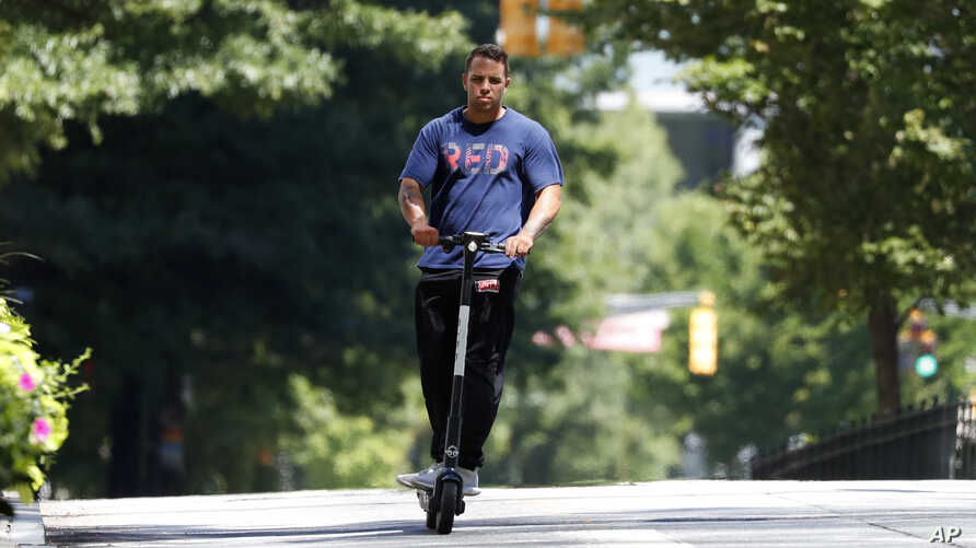 A man rides an electric scooter in Atlanta, Georgia, Aug. 8, 2019.