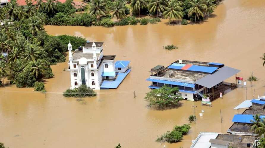 This  Aug. 11, 2019 photograph released by Indian Navy, shows a flooded area of Malappuram district, Kerala as seen from an Indian Navy helicopter.