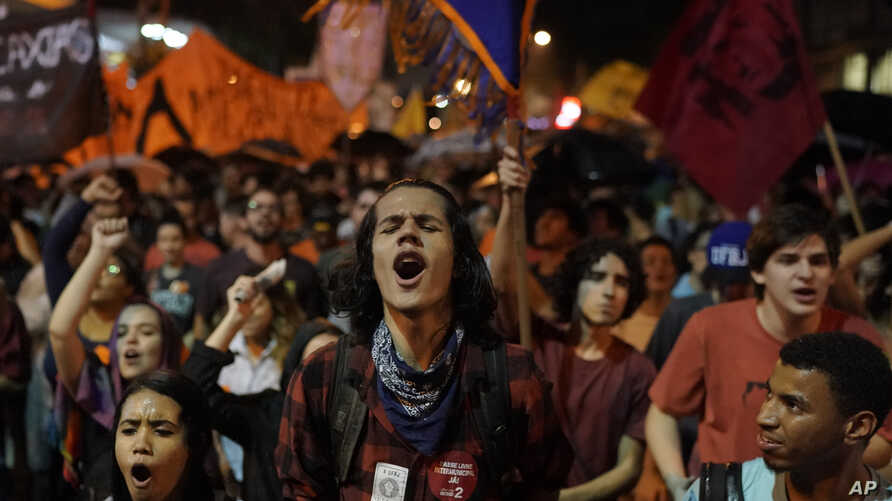 People protest government education budget cuts in Rio de Janeiro, Brazil, Aug. 13, 2019.