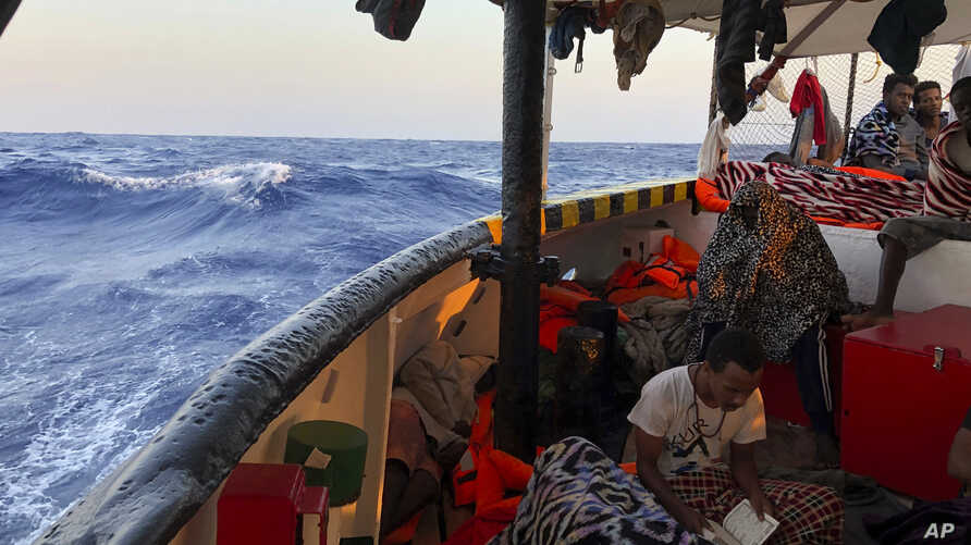 boat as it arrives near Lampedusa coast in the Mediterranean Sea, Aug.15, 2019.
