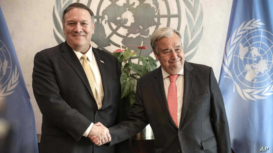 Secretary-General of the U.N. António Guterres, right, greets U.S. Secretary of State Mike Pompeo during his visit to attend a meeting of the U.N. Security Council on the Mideast, Aug. 20, 2019 in New York.