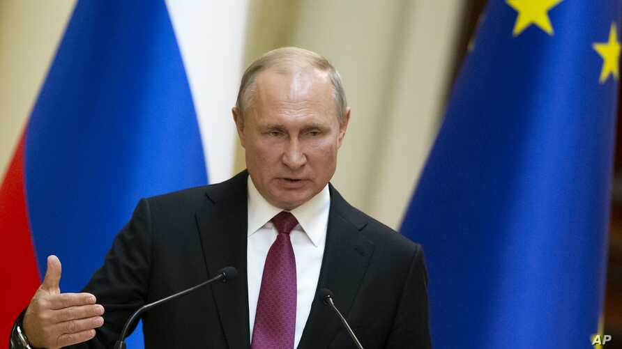 Russian President Vladimir Putin speaks during a news conference in Helsinki, Finland, Aug. 21, 2019.