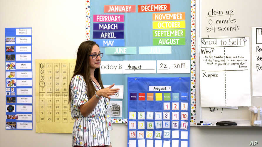 First-grade teacher Hillary Madrigal works in her classroom in Salt Lake City, Aug. 22, 2019. Madrigal jumped to the nearby scho