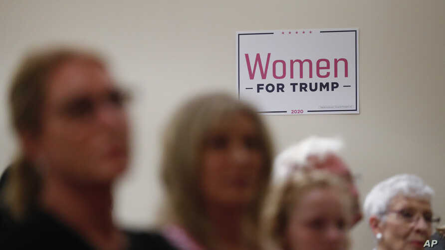 Women listen during a training session for Women for Trump, An Evening to Empower, in Troy, Mich., Aug. 22, 2019.