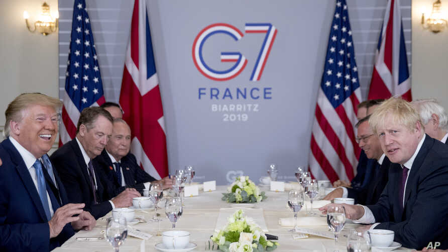 President Donald Trump and Britain's Prime Minister Boris Johnson, right, attend a working breakfast at the Hotel du Palais on the sidelines of the G-7 summit in Biarritz, France, Aug. 25, 2019.