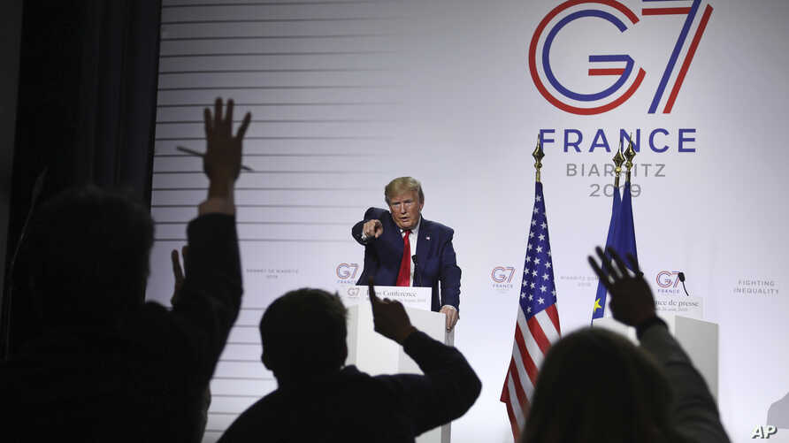 President Donald Trump takes questions during a press conference on the third and final day of the G-7 summit in Biarritz, France, Aug. 26, 2019.