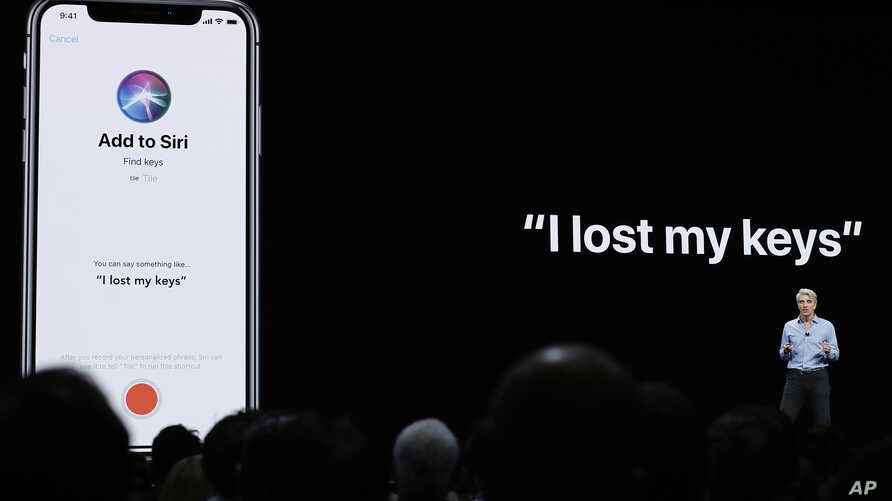 FILE - Craig Federighi, Apple's senior vice president of Software Engineering, speaks about Siri during an announcement of new products at the Apple Worldwide Developers Conference in San Jose, California, June 4, 2018.